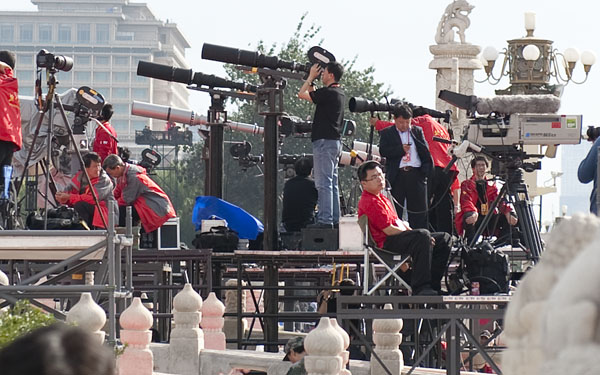 Chinese media with long lenses at the ready to shoot their leaders