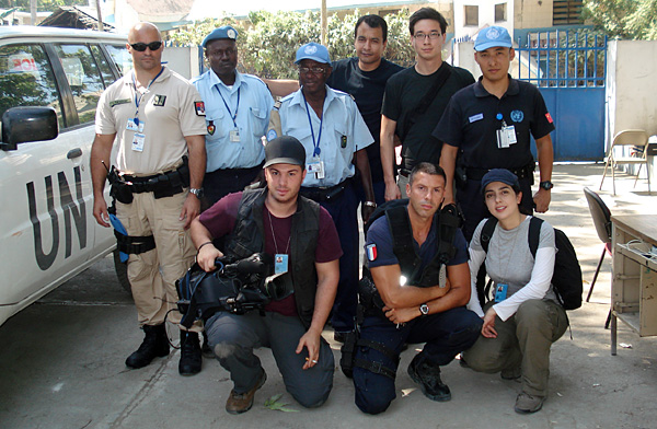 Posing with aid workers - the team all ready to shoot the news with the Panasonic HPX-500