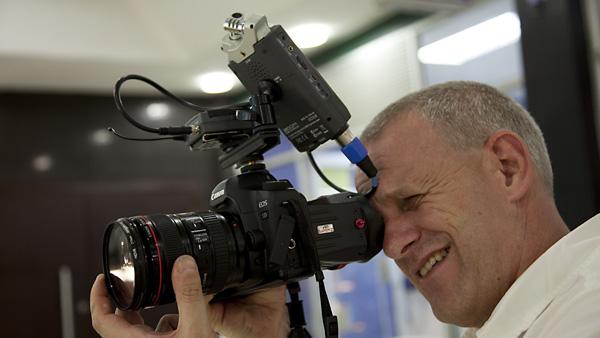DJ Clark shows students a basic Canon 5DmkII video kit