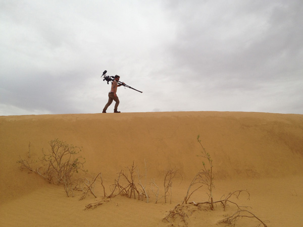 Jake shooting morning time-lapses in the Sahara with a C300 for the Mauritania piece.  Photo: Jerry Ricciotti
