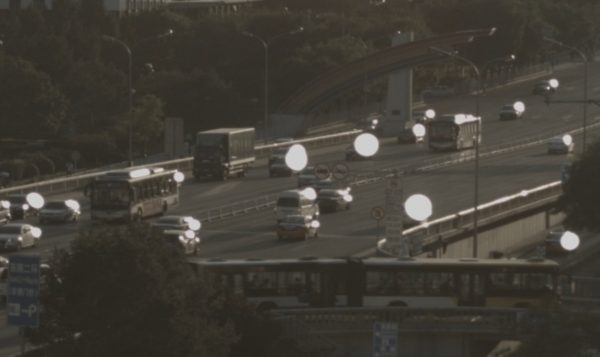 The 'White orb' effect seen on passing cars in late afternoon