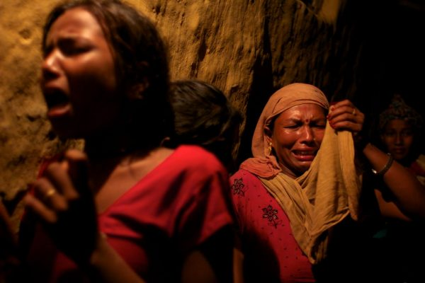 Meena, 35, mourns the death of her cousin, Ganesh Bishwakarma, as his body is brought home from Qatar to the village of Dharana, Dang district, Nepal