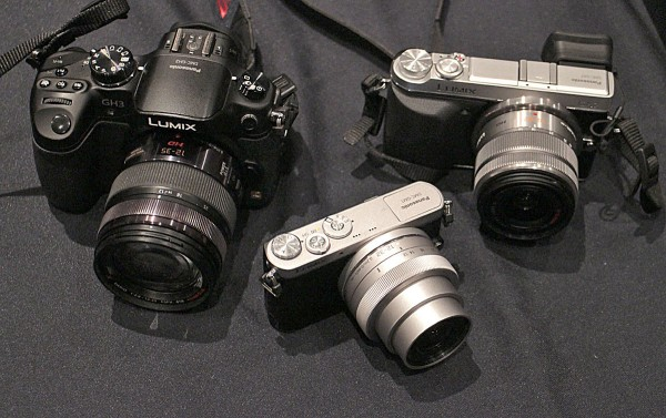 The Lumix DMC-GM1, center, is tiny compared to the GH3 at left and the GX7 at right.