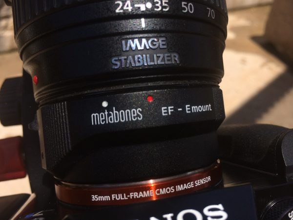 You need the latest version of the Metabones EF to E mount adapter to work with full-frame glass