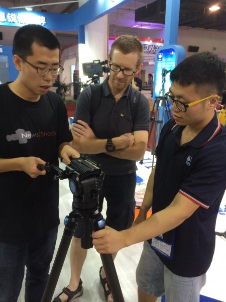 Checking out a Sirui pro video tripod on their booth