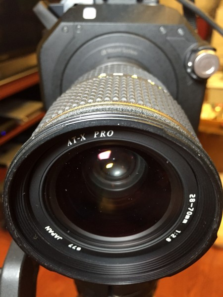 Not as good as a Zeiss, but at $100 used this very possibly the cheapest quality 28-70 f2.8 out there