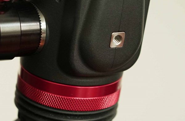 There is a 1/4 20 mounting hole on the base of the EVF