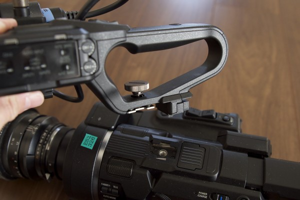 The camera features a removable top handle with XLR inputs and full audio controls
