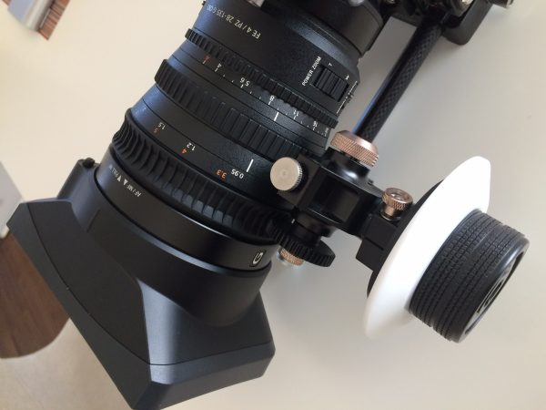 You can use a follow focus but it does tend to slip on the rubber focus ring
