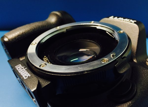 Metabones Speed Booster XL 0.64x mounted on a Panasonic GH4 camera.