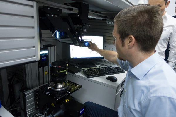 An Engineer demonstrates the K8 machine