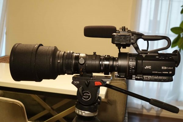 A nikon 300m f2.8 prime lens with a 1.4x extender on the GY-LS300