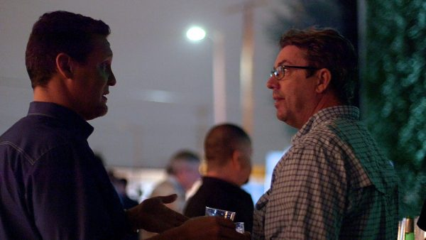 Nicol Verheem and Shane Hurlbut in conversation at the party