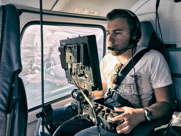 Phil Arntz operating from the rear of the helicopter. Photo: Joseph Hutson/Dubai Film