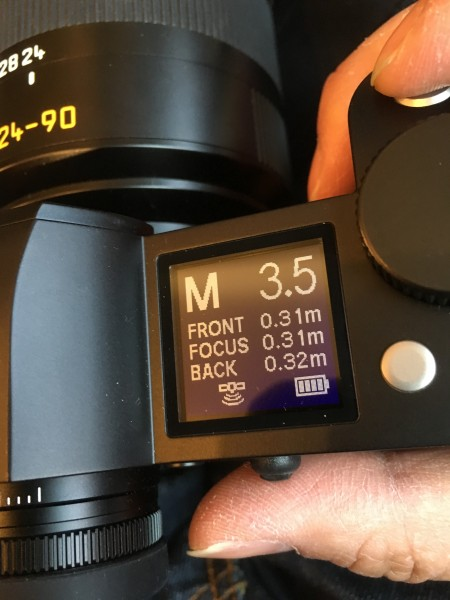 The top plate LCD shows mode, exposure and distance info