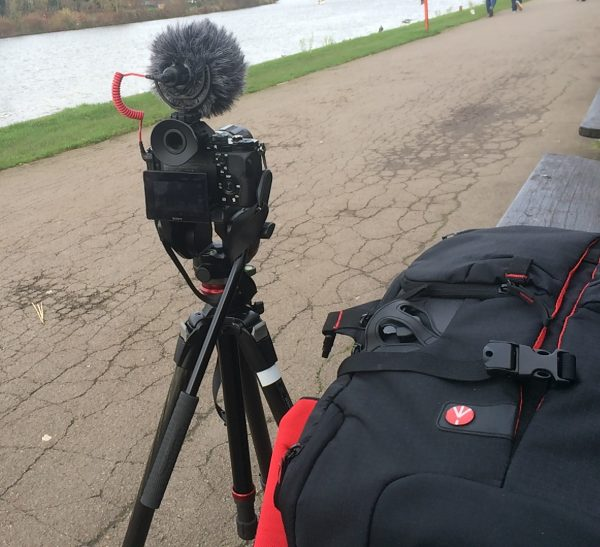 A tripod like this Manfrotto is a good idea