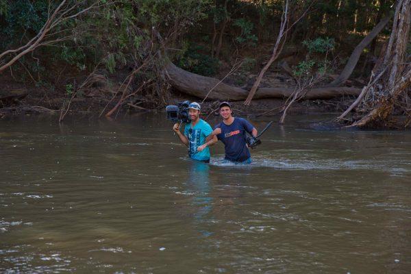 Josh helping Gavin across croc-infested waters in the Cape!