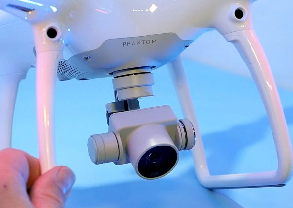 The gimbal on the Phantom 4 is integrated into the body.  The sensors which provide object avoidance and subject tracking are at the top.