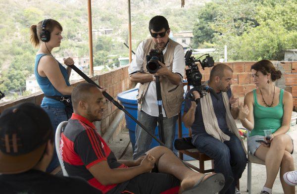 Director Orlando de Guzman (seated) and Producer Lorien Olive (holding boom) in Complexo do Alemao, Rio de Janeiro.