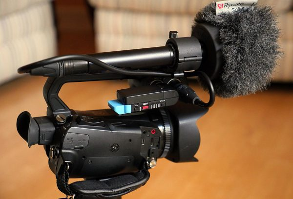 The receiver plugged into a tiny Canon XA25 camera.