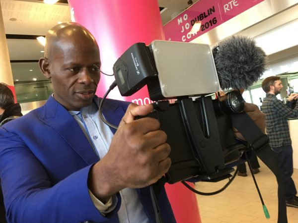 A Mojocon attendee with his iPad video rig
