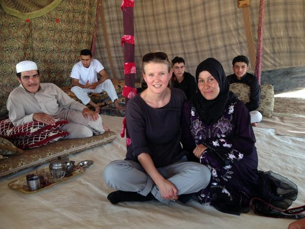Sharron with Syrian Refugee Noor in yhr Jordan Valley. Building a rapport with your subjects is crucial.