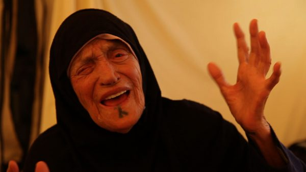 Shahira a Bedouin grandmother from Daraa cries out at the atrocities of Assad in Zaatari refugee camp