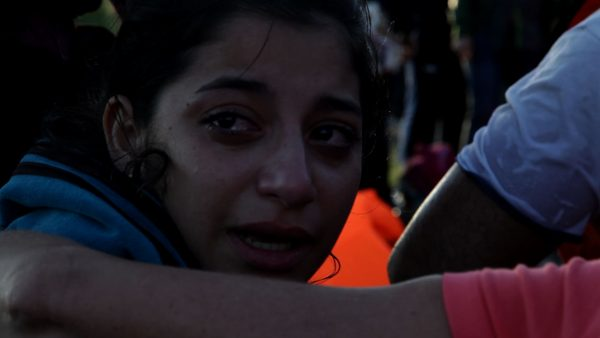 A woman from Damascus, Syria cries after having finally reached the safety of the shores of Lesvos after a frightening journey across the sea from Turkey. Photograph: Sharron Ward
