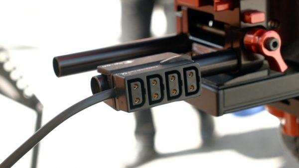 The GC-4 multi D-tap adapter sits on your rails