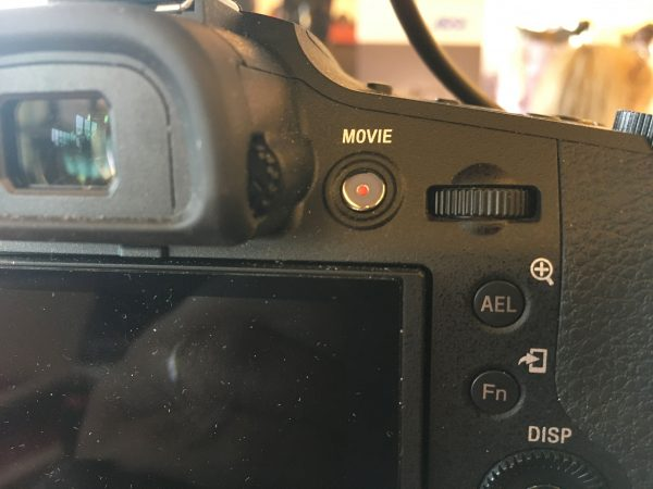 The OLED viewfinder needs a better eyecup. The record button is well placed.