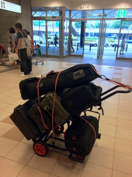 The Kata camera bag that I fly with pictured on the bottom right of the trolley.