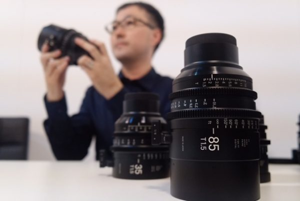 Sigma's Shinji Yamaki shows the new cine lenses at IBC 2016 in Amsterdam