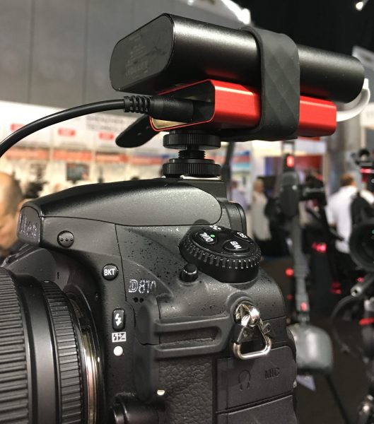 The iFootage E1 with power bank on top of a Nikon DSLR