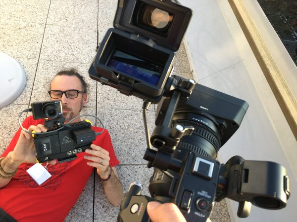 Newsshooter contributor Adrian Storey filming the FS7 II with the RX100 V rig