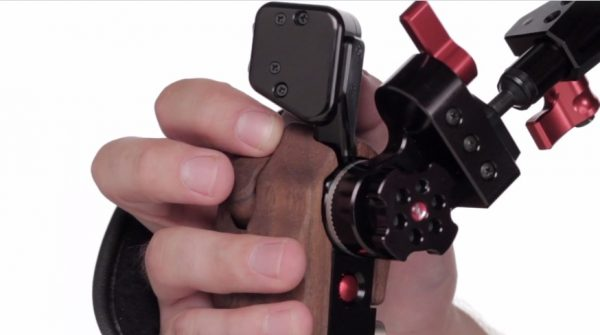 A new wooden handgrip with zoom rocker is teased in the video