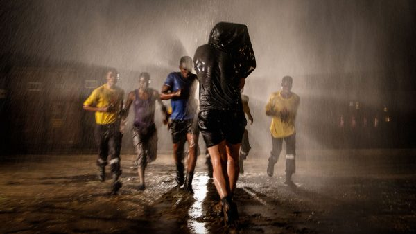 Garth de Bruno Austin using a Blackmagic Ursa Mini 4K on location, filming in torrential rain
