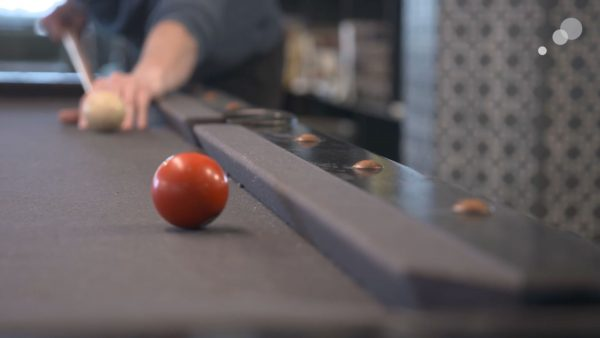 A pool table, as seen in Behind the Lens episode 1