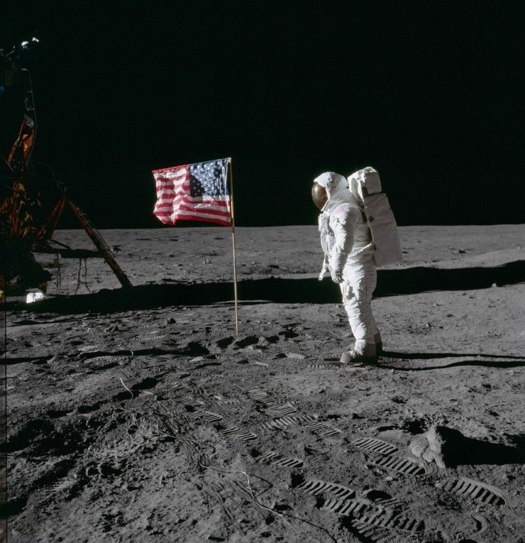 Astronaut Buzz Aldrin poses for photograph beside deployed U S flag © NASA